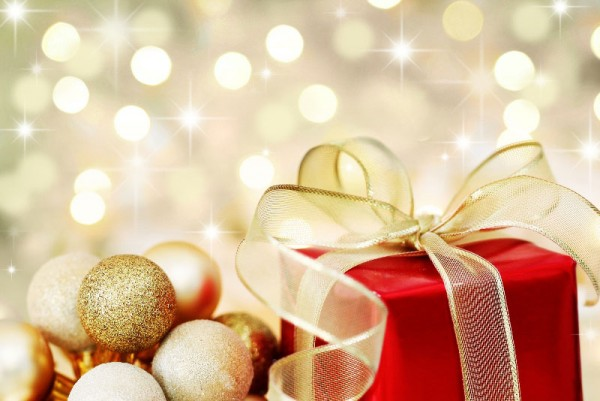 bigstock-Christmas-Gift-On-Defocused-Li-6064726
